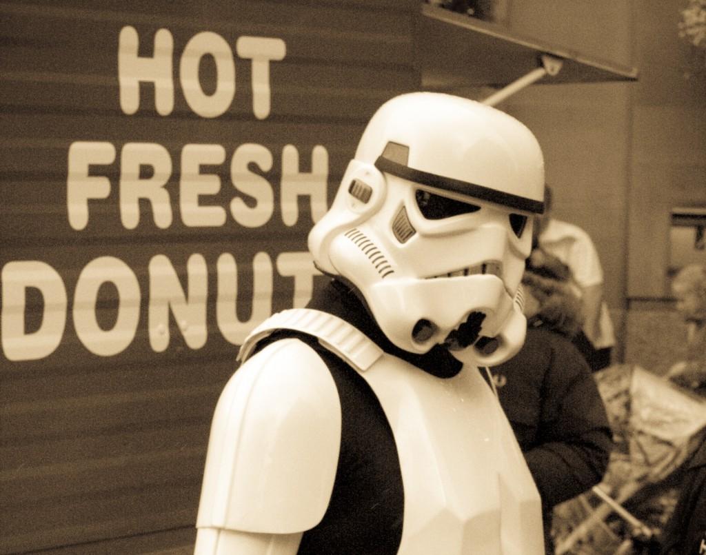Stormtrooper getting a doughnut.